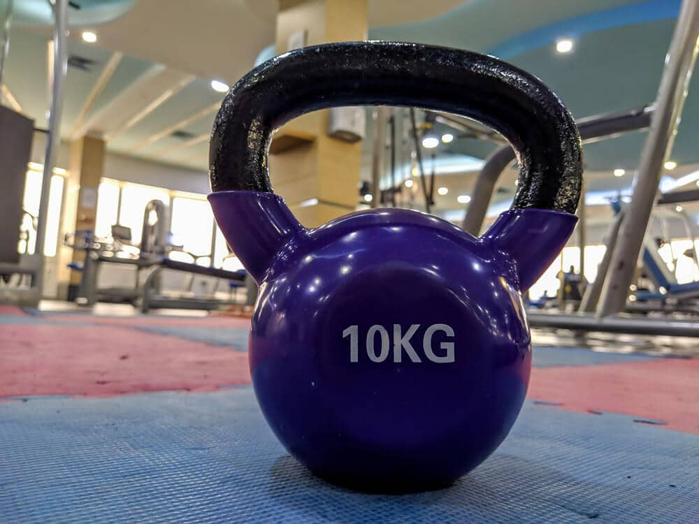 Kettlebell at crossfit gym with lifting bars - Fitness Expo