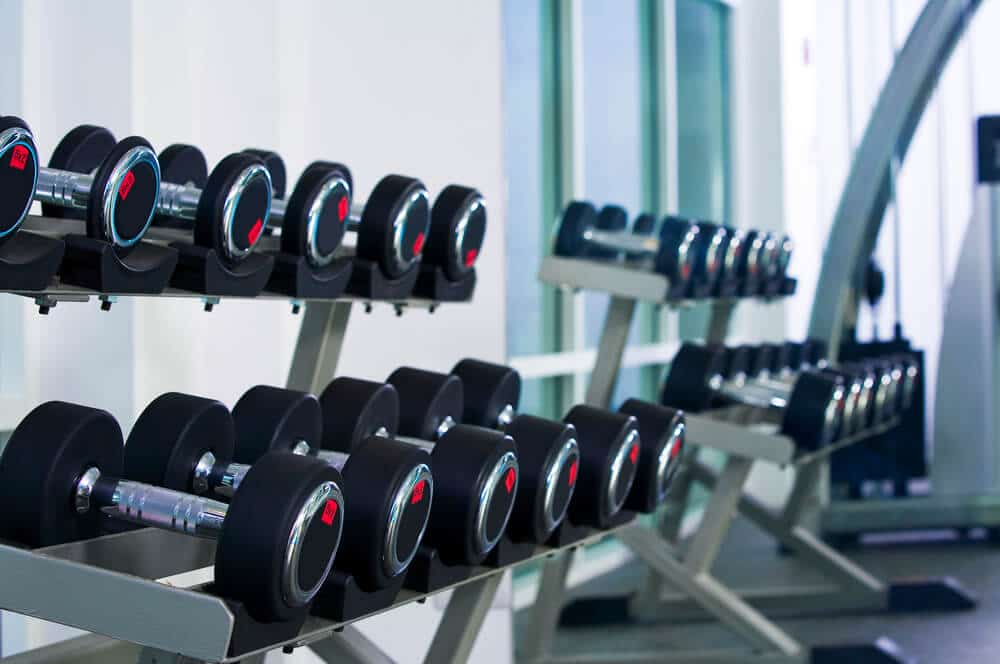 Fragment like view of gym interior with some dumbbells - Fitness Expo