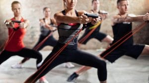 Exercise class with stretching band - Fitness Expo