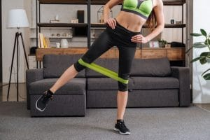 Partial view of sportswoman training with resistance Band - Fitness Expo