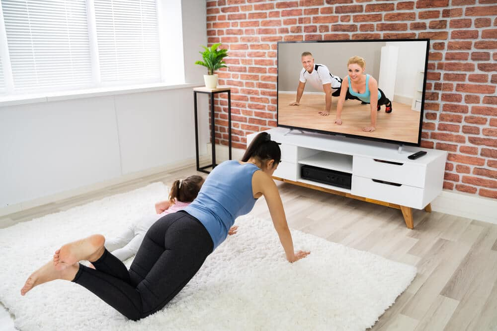 Women exercise with a big TV screen | Fitness Expo