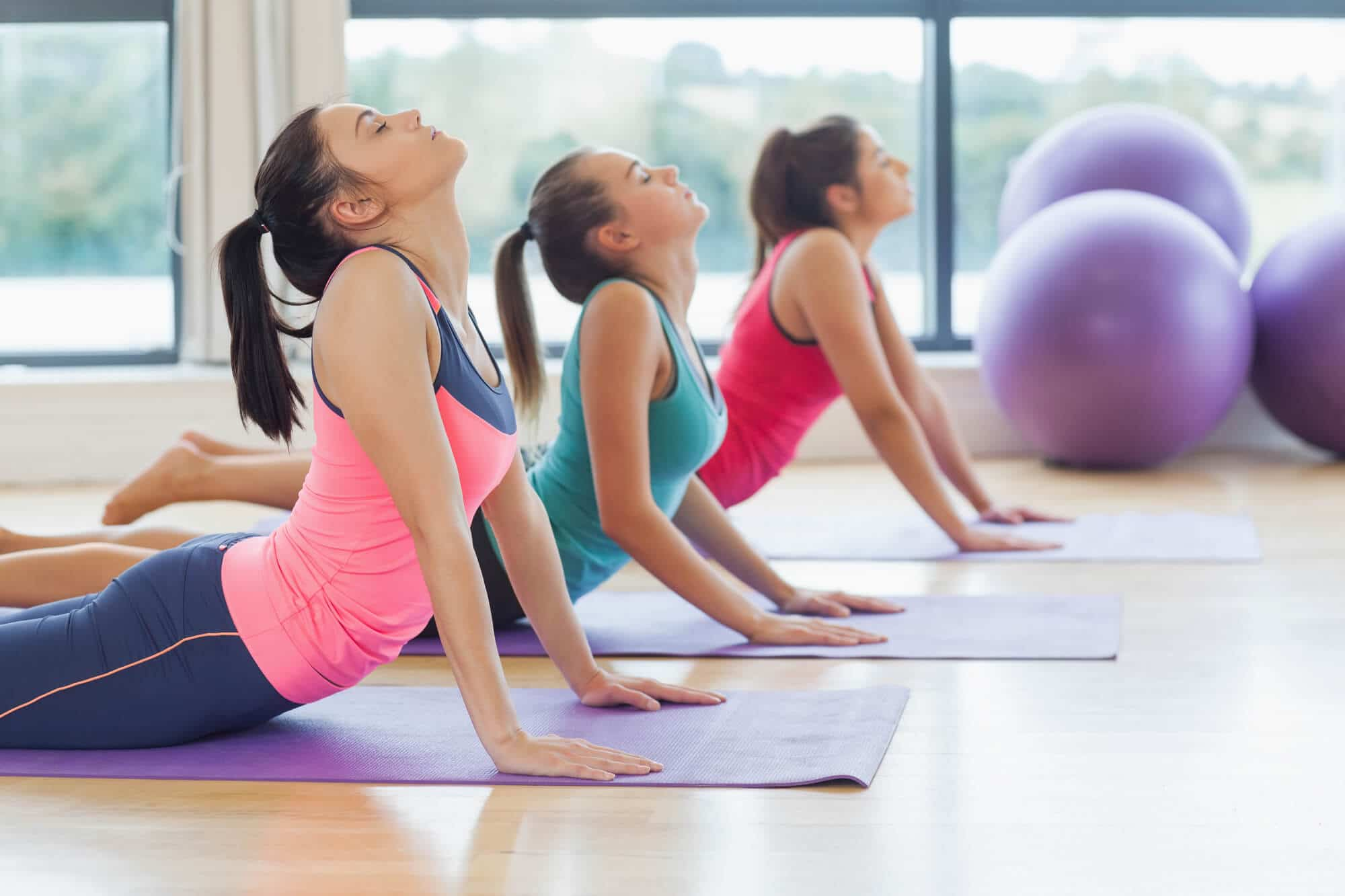 women doing cobra stretch - Fitness Expo