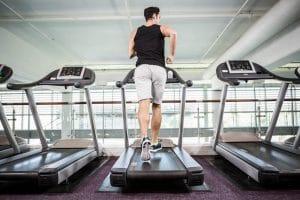 Fit man running on treadmill - Fitness Expo