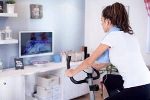 Woman training on exercise bike - Fitness Expo