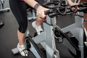 Woman working out on exercise bike - Fitness Expo