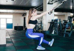 Woman doing squatting one leg exercise - Fitness Exercise