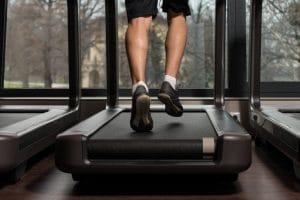 Fitness Man Running On Treadmill - Fitness Expo